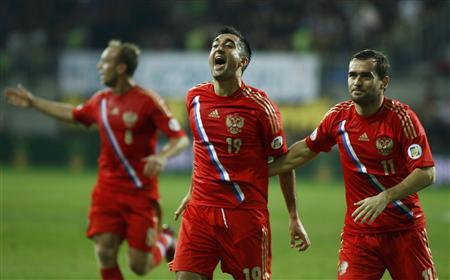 Russia's Samedov, Kerzhakov and Glushakov celebrate a goal scored by their team mate Shirokov during the 2014 World Cup qualifying soccer match against Azerbaijan in Baku